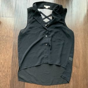 Black buttoned top with criss cross cutout in the back. Size M.